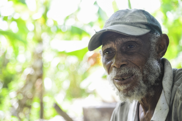 Joseph Thompson, a small farmer in St. Catherine, Jamaica has been farming this plot of land for over twenty years but says he has not been able to regularised tenure because changes of national leadership has resulted in a lack of continuity. The land should be leased for JA$25,000 (US$120) per year but the land has not yet been measured. He pays for water to irrigate his crops which include callaloo okra, banana, cassava, dasheen, sorrel.