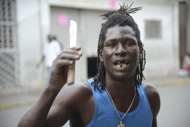 A fish vendor in conversation on the streets of Port Maria, Jamaica on November 29 2014.