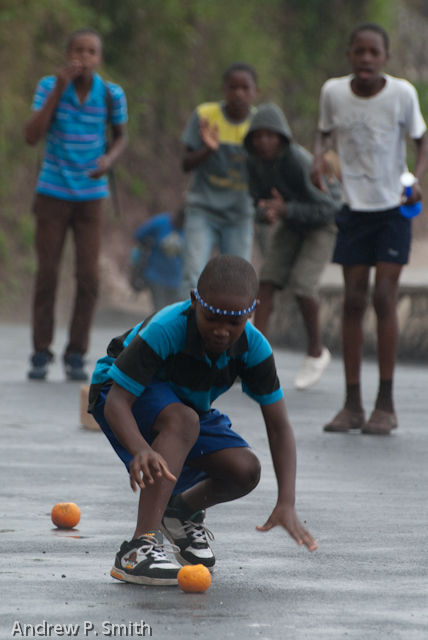 A student participates in a potato race while urged on by his team-mates during the sports day of Cascade Primary School in the Blue Mountains of Portland, Jamaica on March 27 2013. Sports day was held on a newly repaired stretch of road which had previously been destroyed by a landslide since 2004.