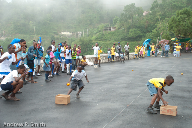 Students compete in the potato race during sports day at the Cascade Primary School in the Blue Mountains of Portland, Jamaica on March 27 2013. Sports day was held on a newly repaired stretch of road which had previously been destroyed by a landslide since 2004.