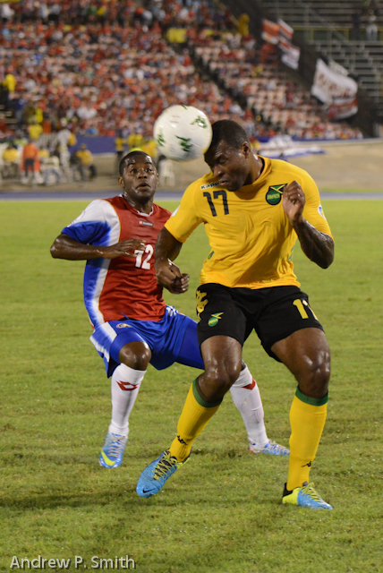 Jamaica's Westley Morgan heads the ball under pressure from Costa Rica's Joel Campbell.