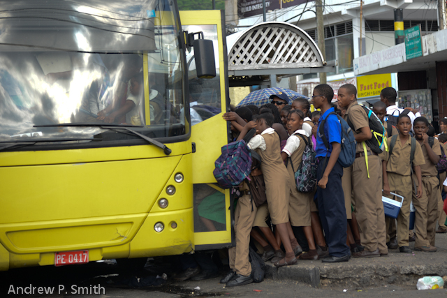 School children boarding a bus.