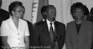 Former Haitian President Jean-Bertrand Aristide is flanked by his wife Mildred  (left) and Congresswoman Maxine Waters during a press conference at the presidential palace on February 21 2004.