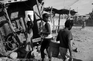 Residents of St. Marc collect water on February 22, 2004.