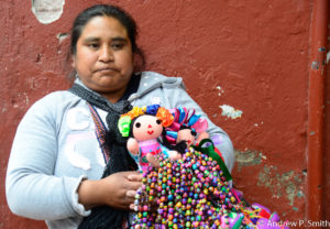 A vendor pauses from selling her wares in San Miguel de Allende.